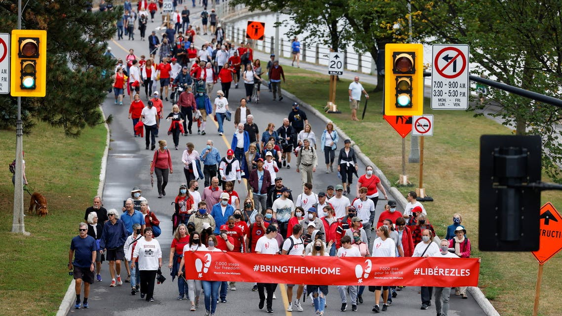 Supporters of Michael Kovrig and Michael Spavor march to mark 1,000 days since the Canadians were arrested in China, during a protest in Ottawa, Ontario, Canada September 5, 2021. (Reuters)