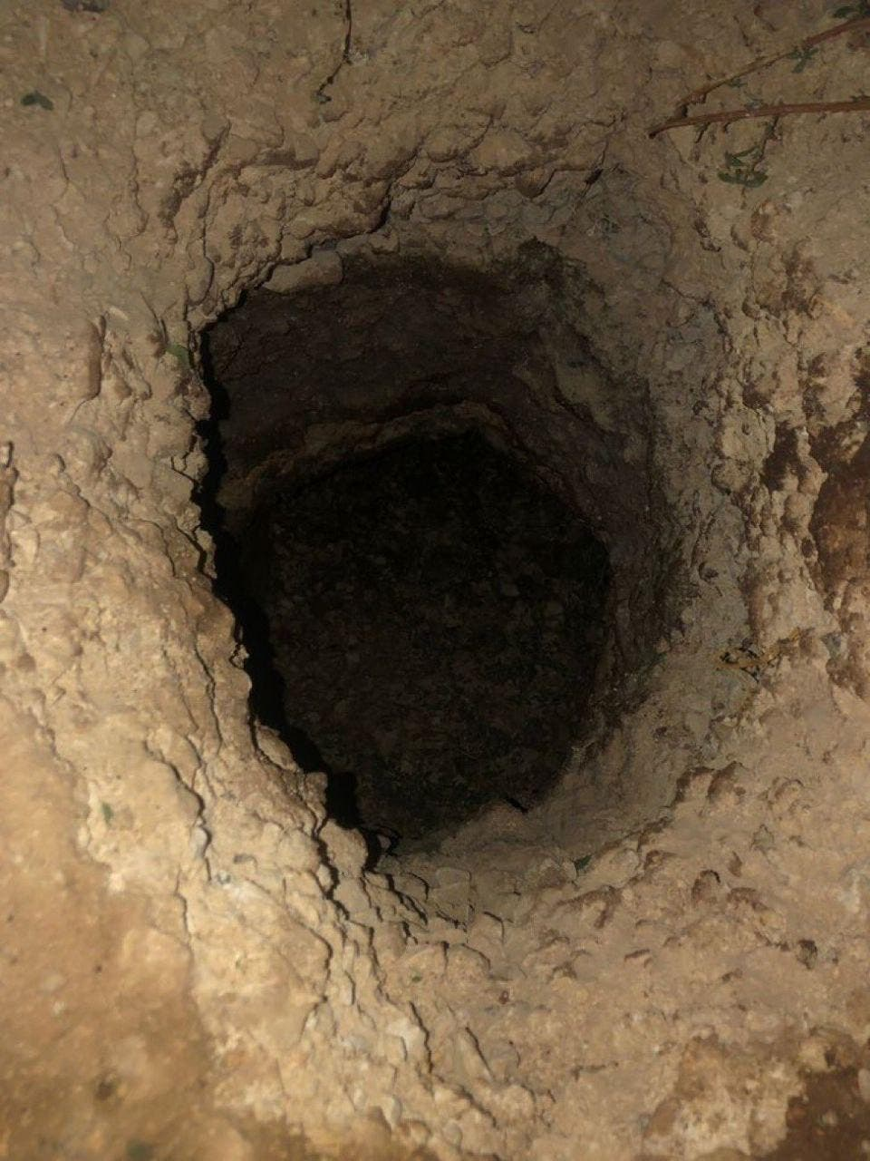 The tunnel through which the prisoners escaped