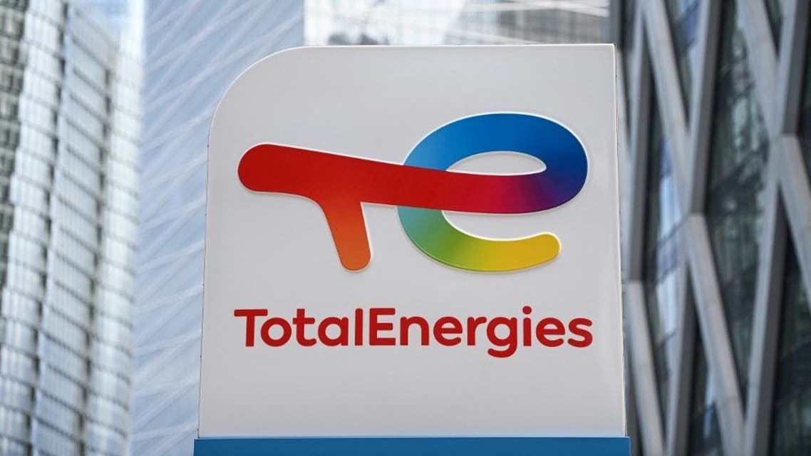 This photograph taken on May 28, 2021 shows the new TotalEnergies logo during its unveling ceremony, at a charging station in La Defense on the outskirts of Paris. (AFP)