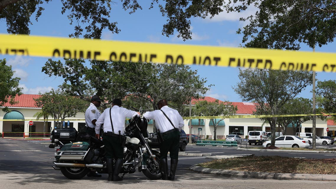 Palm Beach County Sheriff's officers stand outside of a Publix supermarket where a woman, child and a man were found shot to death on June 10, 2021 in Royal Palm Beach, Florida. (File photo: AFP)