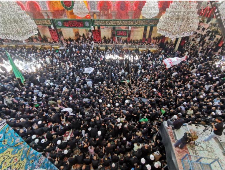 ہزاروں لوگ  آية الله محمد سعيد الحكيم کے سفر آخرت میں