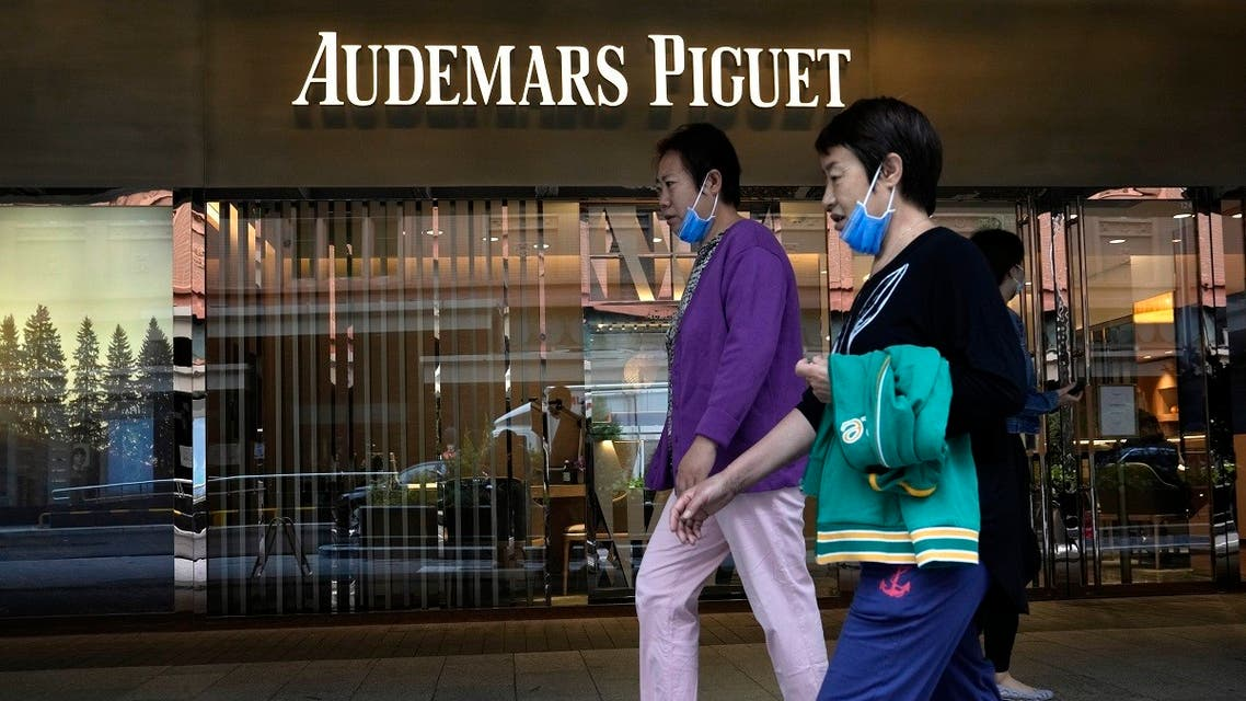 Visitors to a mall walk past the Audemars Piguet store in Beijing on September 6, 2021. (AP)