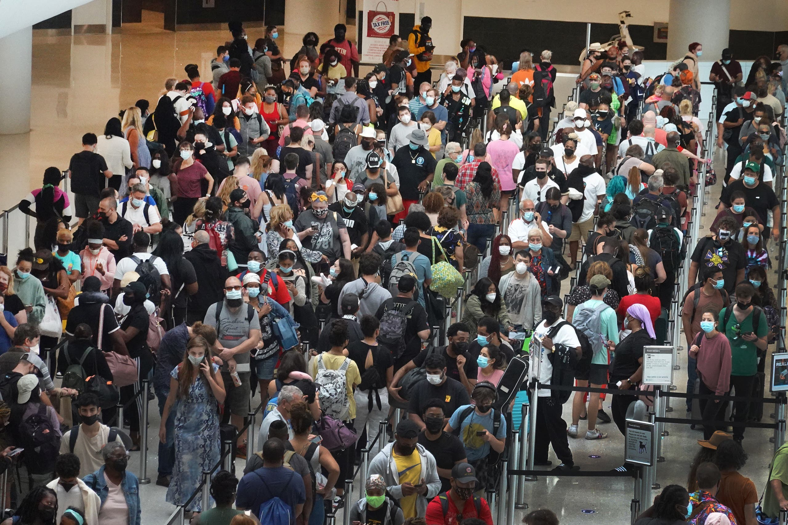 People stand in line to get through the TSA security checkpoint at Louis Armstrong New Orleans International Airport on August 28, 2021 in New Orleans, Louisiana. (AFP)