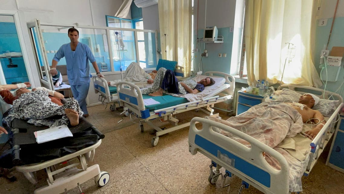 Wounded Afghan men receive treatment at a hospital after explosions outside airport in Kabul, Afghanistan August 27, 2021. (Reuters)