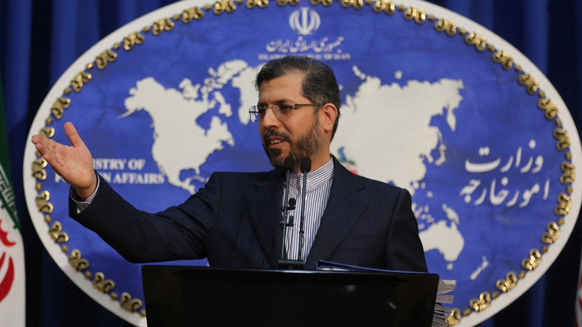 Iranian foreign ministry spokesman Saied Khatibzadeh gestures during a press conference in Tehran on February 22, 2021. Iran hailed as a significant achievement a temporary agreement Tehran reached with the head of the UN nuclear watchdog on site inspections. That deal effectively bought time as the United States, European powers and Tehran try to salvage the 2015 nuclear agreement that has been on the brink of collapse since Donald Trump withdrew from it.