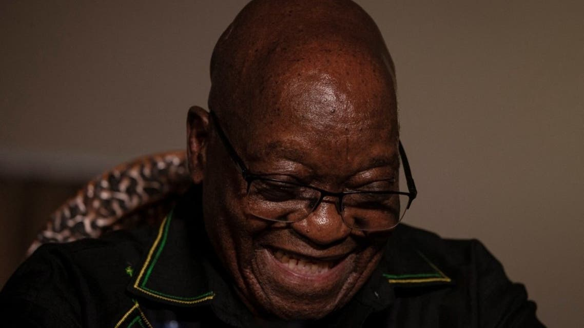 In this file photo taken on July 04, 2021 Former South African president Jacob Zuma laughs as he addresses the media in his home in Nkandla, KwaZulu-Natal. (AFP)