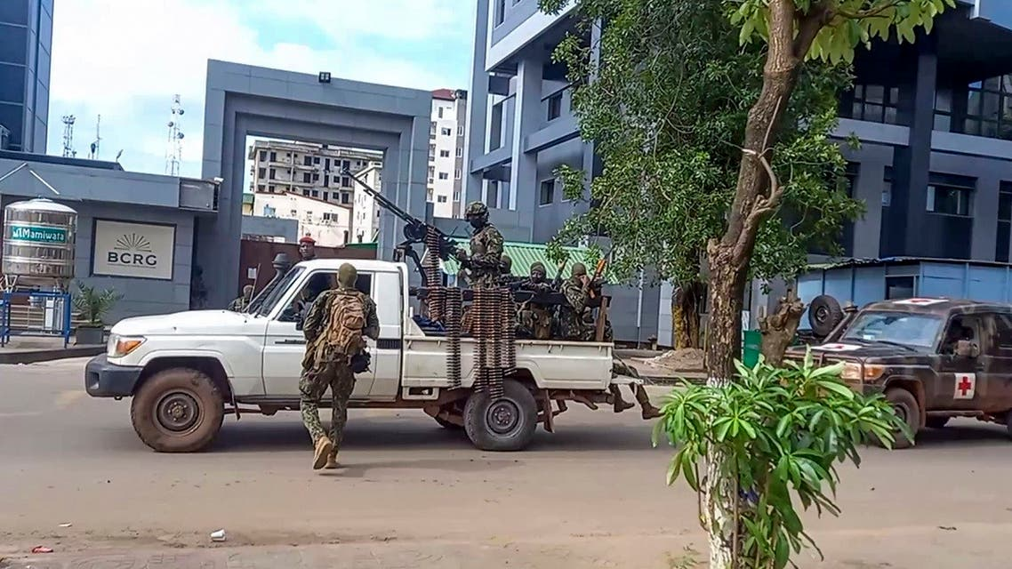 In this image made from video, unidentified soldiers patrol in a vehicle near the office of the president in the capital Conakry, Guinea, on Sept. 5, 2021. (AP)