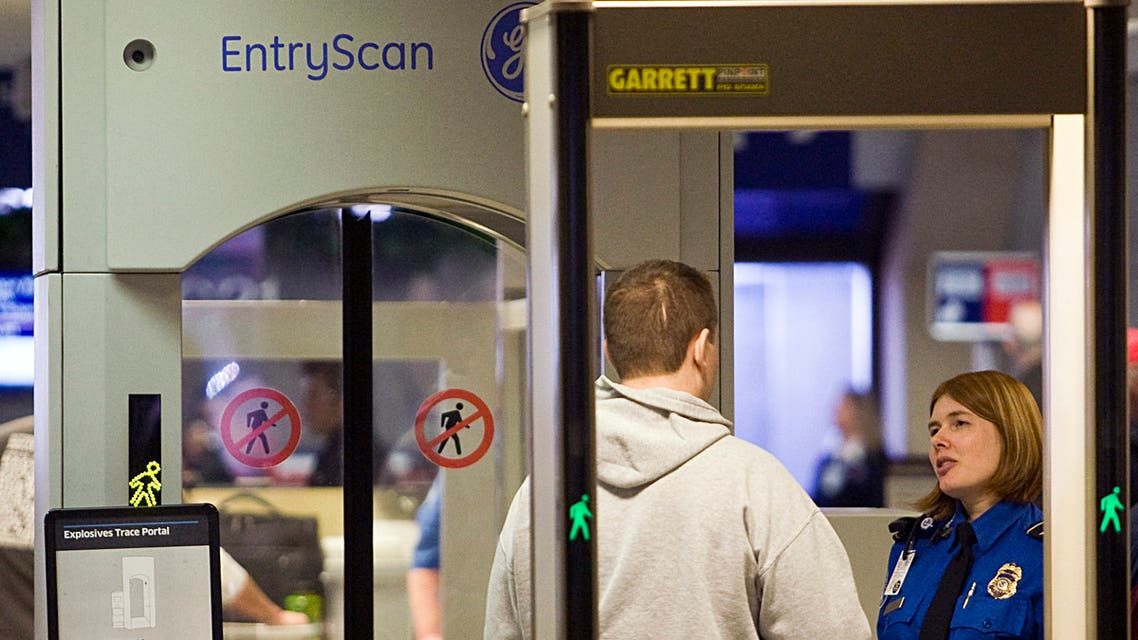 A TSA officer screens an airline passenger in Terminal C at Dallas/Fort Worth International Airport December 27, 2009 in Dallas, Texas. (AFP)