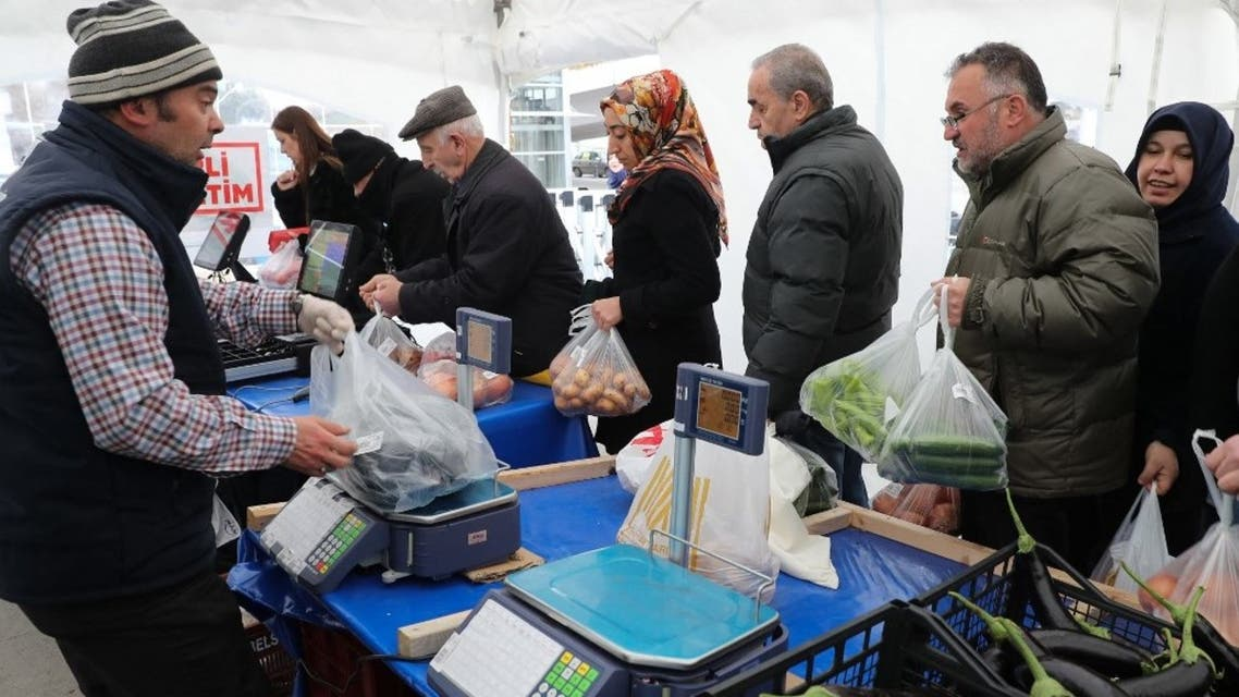 People queue to buy vegetables at a tent set up by the Ankara metropolitan municipality in the Çankaya district of Ankara on February 13, 2019. (AFP)