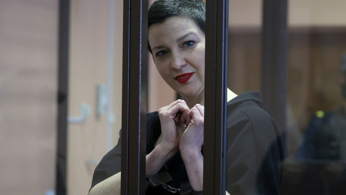 Belarusian opposition politician Maria Kolesnikova, charged with extremism and trying to seize power illegally, gestures inside a defendants' cage as she attends a court hearing in Minsk, Belarus September 6, 2021. (Reuters)
