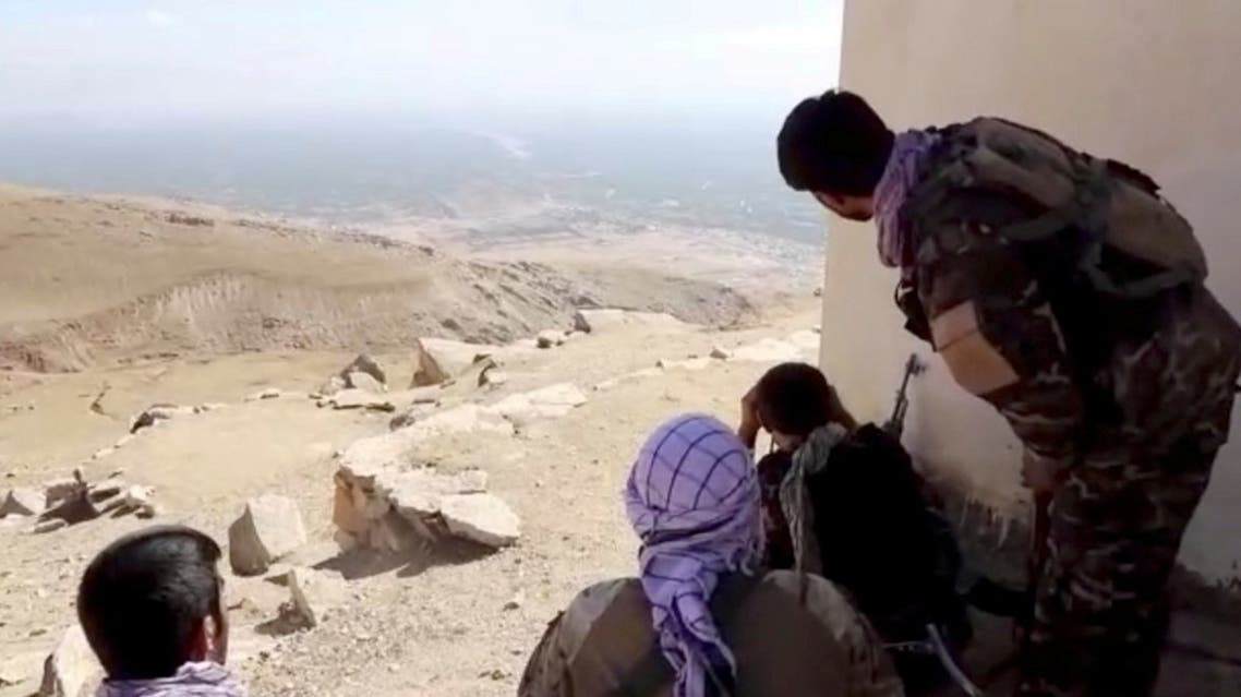 Members of National Resistance Front observe by a house near Panjshir Valley, Afghanistan in this still image obtained from an undated video handout. (National Resistance Front of Afghanistan/Handout via Reuters)