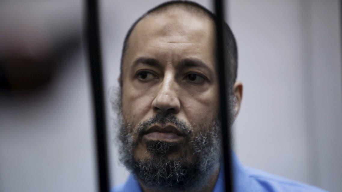 Saadi Gaddafi, son of Muammar Gaddafi, sits behind bars during a hearing at a courtroom in Tripoli, Libya February 7, 2016. (Reuters)