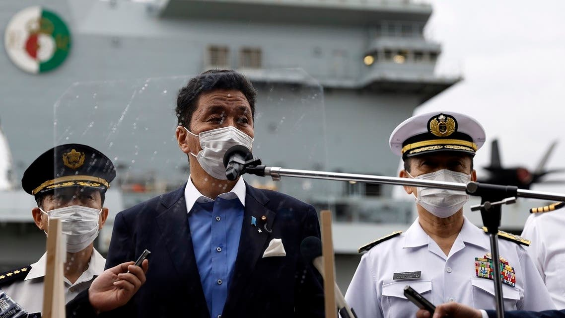 Japan Defense Minister Nobuo Kishi speaks to media after he inspected the British Royal Navy's HMS Queen Elizabeth aircraft carrier (back), at the US naval base in Yokosuka, Kanagawa Prefecture, Japan, on Sept. 6, 2021.  (AP)