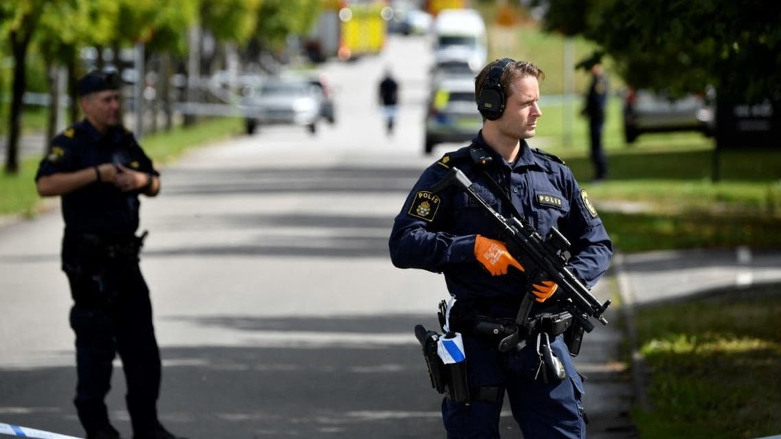 Police are seen near the scene of an apparent attack at a school in Esloev, southern Sweden, on August 19, 2021. (AFP)