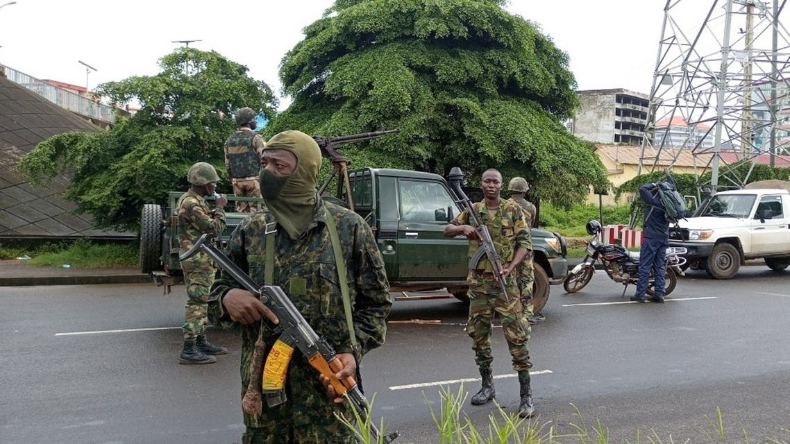 Army soldiers hold a checkpoint after the uprising that led to the toppling of President Alpha Conde in Kaloum neighborhood of Conakry in Guinea, September 6, 2021. (Reuters/Souleymane Camara)