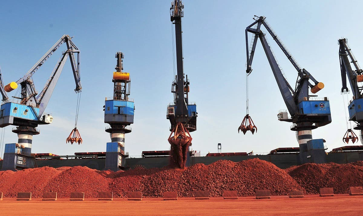 A ship carrying bauxite from Guinea is unloaded at a port in Yantai, Shandong province, China May 15, 2017. (Reuters/Stringer)