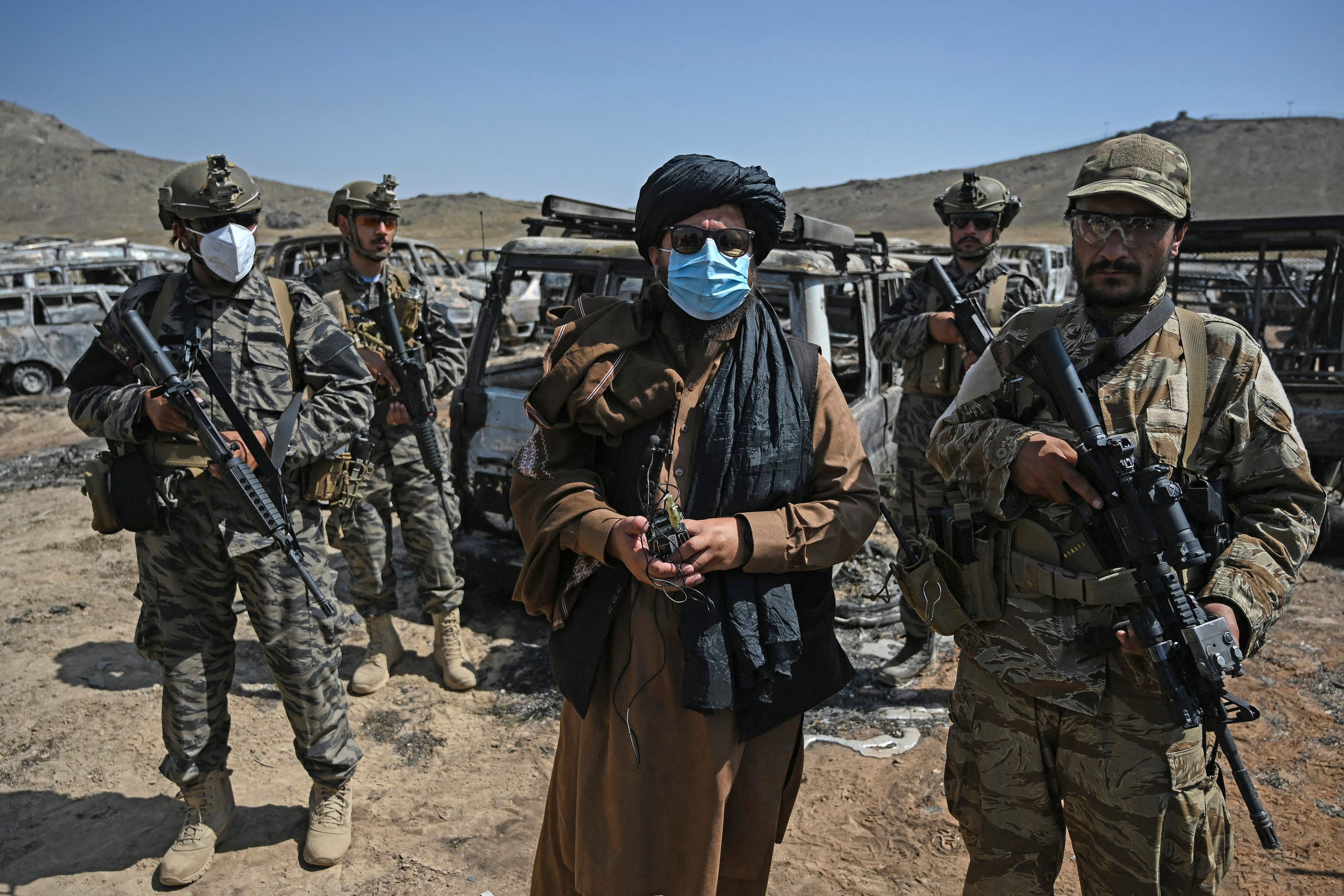Members of the Taliban Badri 313 military unit stand beside damaged and discarded vehicles parked near the destroyed Central Intelligence Agency (CIA) base in Deh Sabz district northeast of Kabul on September 6, 2021 after the US pulled all its troops out of the country. (File photo: AFP)