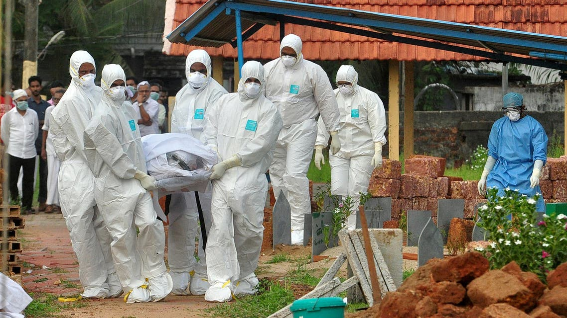 Doctors and relatives wearing protective gear carry the body of a victim, who lost his battle against the brain-damaging Nipah virus, during his funeral at a burial ground in Kozhikode. (File photo: Reuters)
