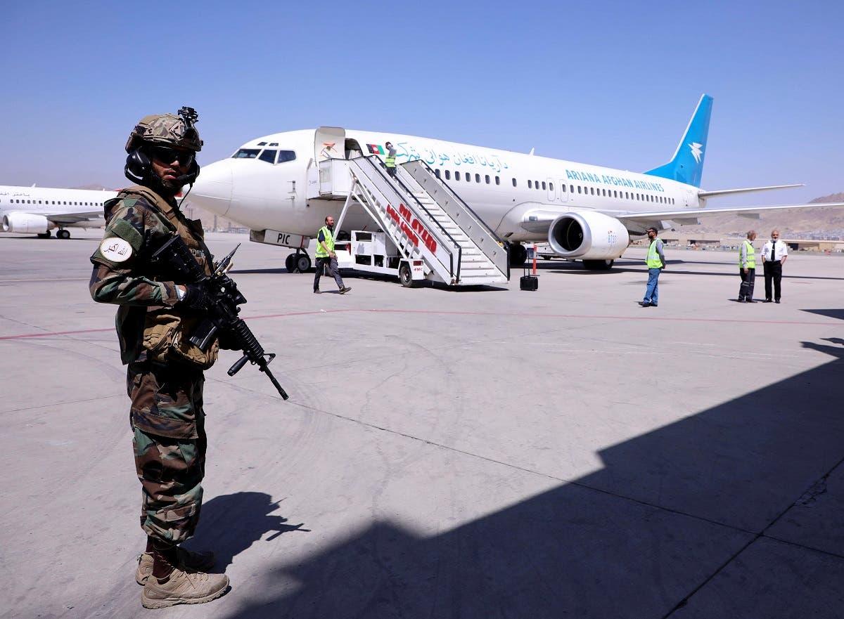 A Taliban fighter at Kabul airport (Reuters)