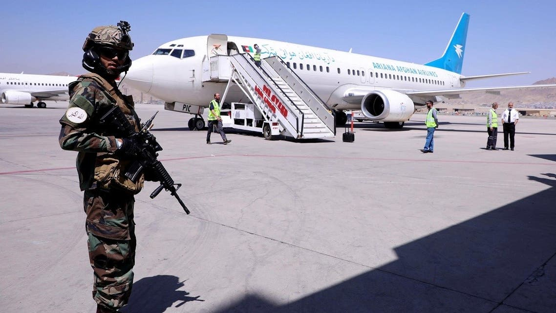A member of Taliban forces stands guard next to a plane that has arrived from Kandahar at Hamid Karzai International Airport in Kabul, Sept. 5, 2021. (Reuters)