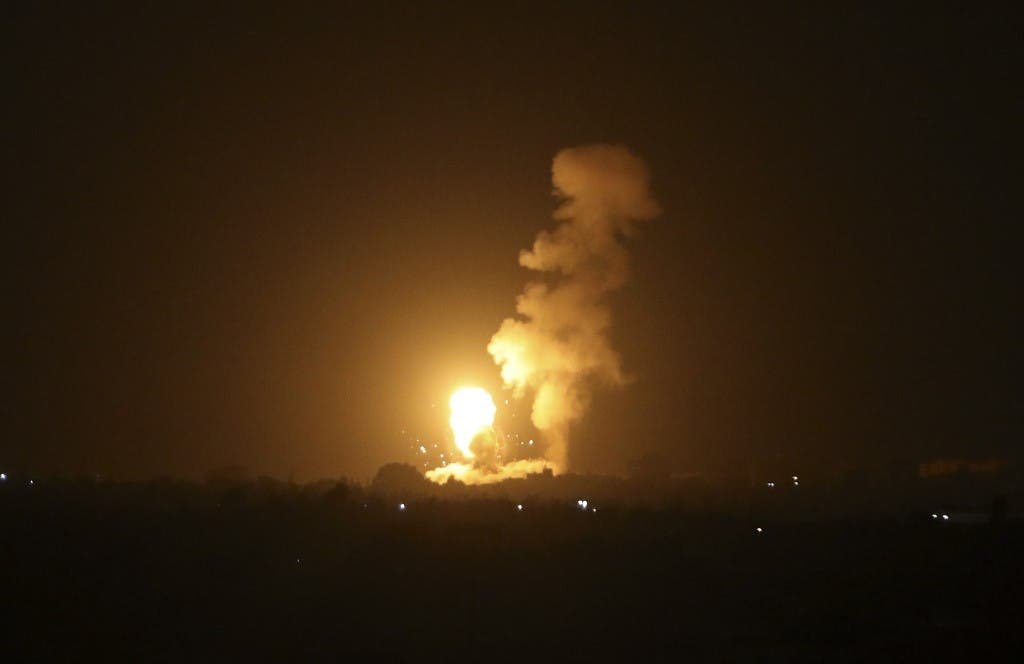 A fireball rises following an air strike in Khan Yunis in the southern Gaza Strip, late on September 6, 2021. (AFP)
