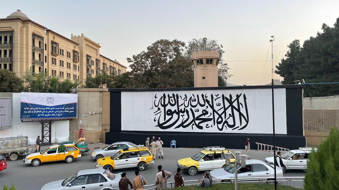 A giant Taliban flag painted over the entrance of the former US Embassy building in Afghanistan's capital Kabul. (Twitter)