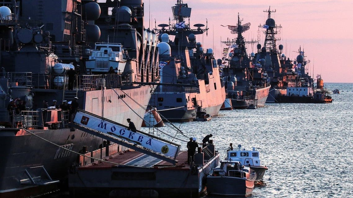 Russian warships are seen ahead of the Navy Day parade in the Black Sea port of Sevastopol, Crimea July 23, 2021. (Reuters/Alexey Pavlishak)