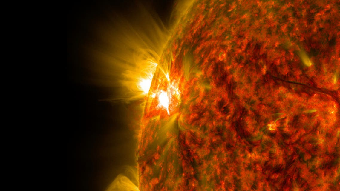 This NASA image obtained November 6, 2014 shows an active region on the sun as it emitted a mid-level solar flare, peaking at 4:47 a.m. EST on November 5, 2014. This is the second mid-level flare from the same active region, labeled AR 12205, which rotated over the left limb of the sun on November 3, 2014. The image was captured by NASA's Solar Dynamics Observatory (SDO) in extreme ultraviolet light that was colorized in red and gold. Solar flares are powerful bursts of radiation. Harmful radiation from a flare cannot pass through Earth's atmosphere to physically affect humans on the ground, however -- when intense enough -- they can disturb the atmosphere in the layer where GPS and communications signals travel. This flare is classified as an M7.9-class flare. M-class flares are a tenth the size of the most intense flares, the X-class flares. The number provides more information about its strength. An M2 is twice as intense as an M1, an M3 is three times as intense, etc. (AFP)