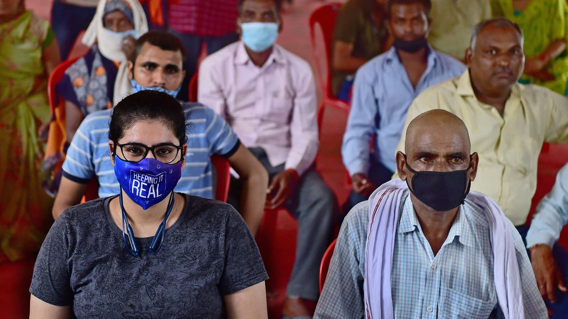 People wait for their turn to get inoculated with the dose of the Covishield vaccine against the Covid-19 coronavirus at a hospital in Allahabad on September 6, 2021. (AFP)