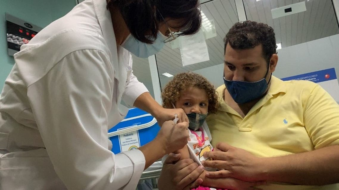 In this file photo taken on August 24, 2021 Pedro Montano holds his daughter Roxana Montano, 3, as she is inoculated against COVID-19 with Cuban vaccine Soberana Plus, at the Juan Manuel Marquez hospital in Havana. (AFP)