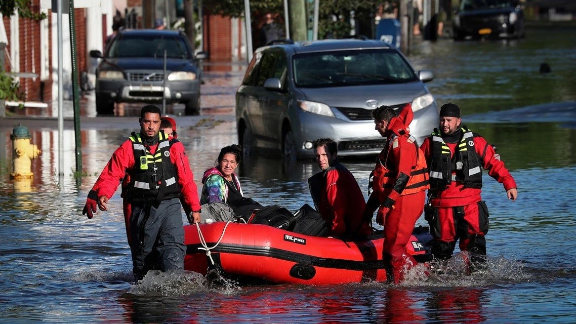 First responders pull local residents trapped by floodwaters after the remnants of Tropical Storm Ida in Mamaroneck, New York, Sept. 2, 2021. (Reuters)