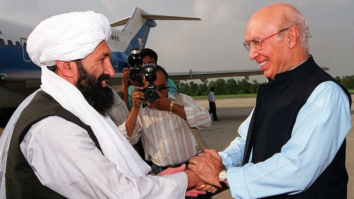 File photo of Afghan Taliban foreign minister Mulla Mohammad Hassan Akhund (L) at an Air Force base in Rawalpindi, some 25 kilometers from Islamabad, meeting his Pakistani counterpart Sartaj Aziz on August 24, 1999. (AFP)