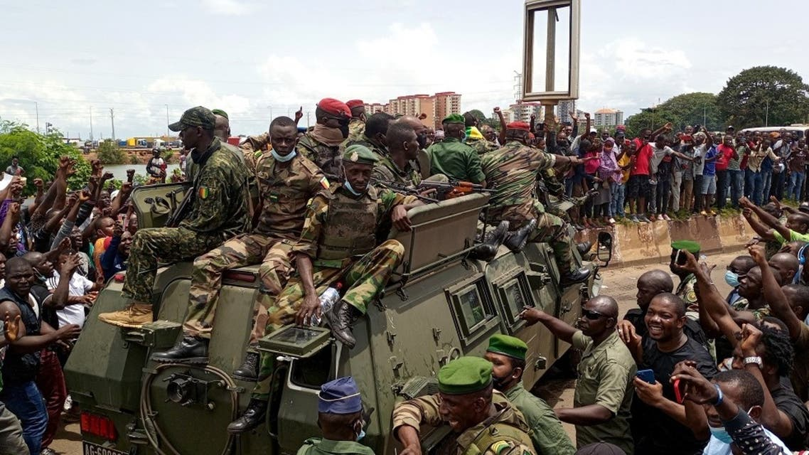 Residents cheer on army soldiers after uprising that led to toppling of president Alpha Conde in Guinea. (Reuters)