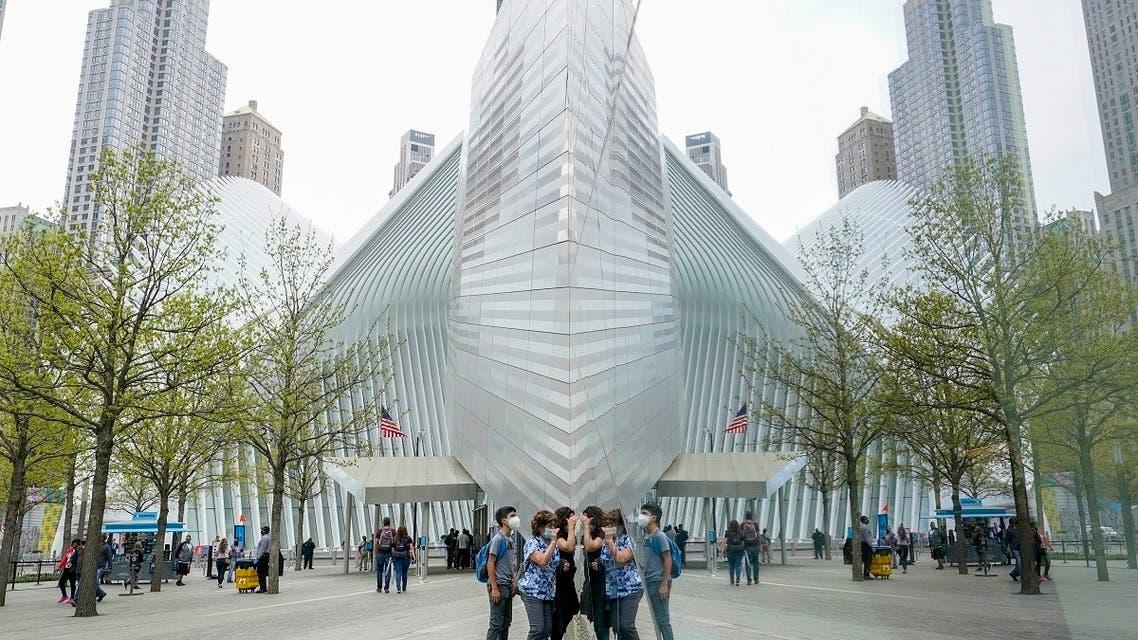 Visitors peek into the museum at the 9/11 Museum & Memorial, April 29, 2021. (AP)