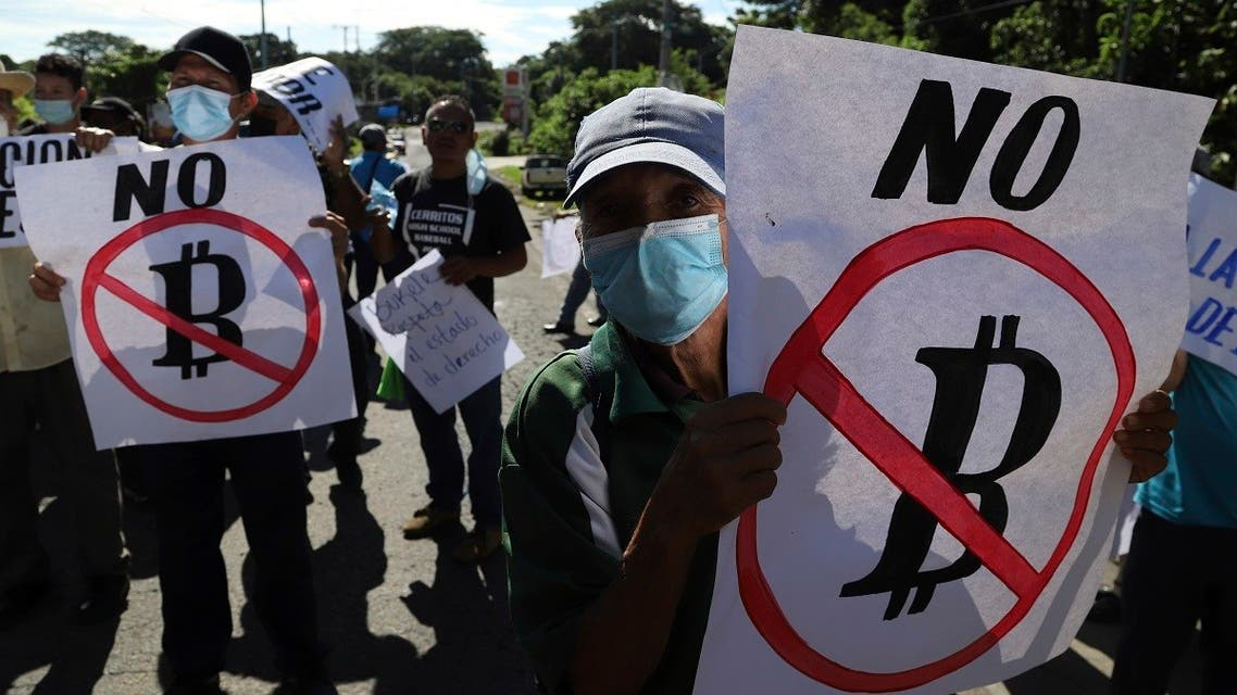 Farmers hold signs emblazoned with messages against the country adopting Bitcoin as legal tender, during a protest along the Pan-American Highway, in San Vicente, El Salvador, Tuesday, Sept. 7, 2021. (AP)