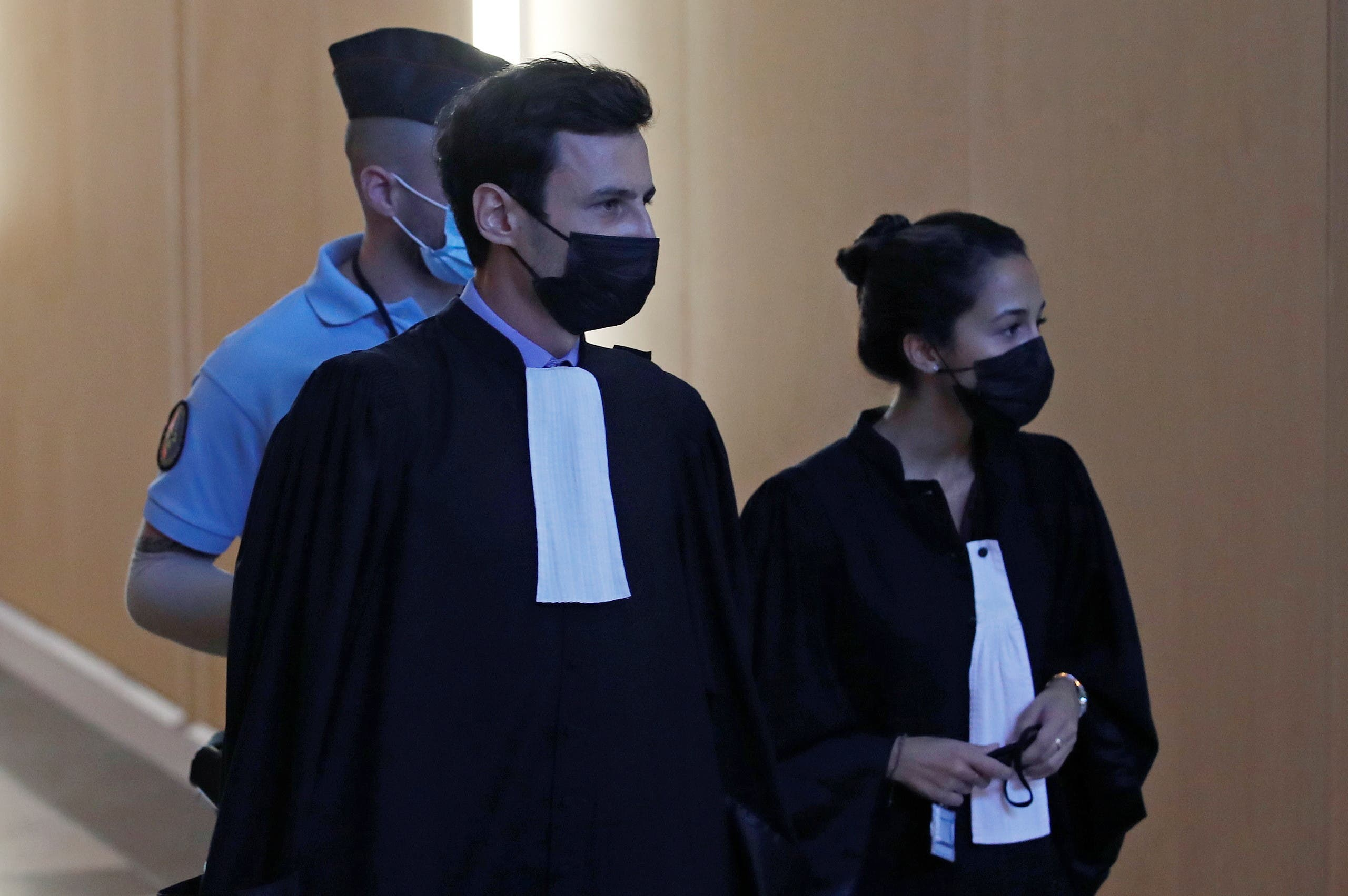 Olivia Ronen and Martin Vettes, lawyers of Salah Abdeslam, one of the accused, who is widely believed to be the only surviving member of the group suspected of carried out the attacks, arrive for the start of the trial of the Paris' November 2015 attacks at the Paris courthouse on the Ile de la Cite, in Paris, France, September 8, 2021. (Reuters)
