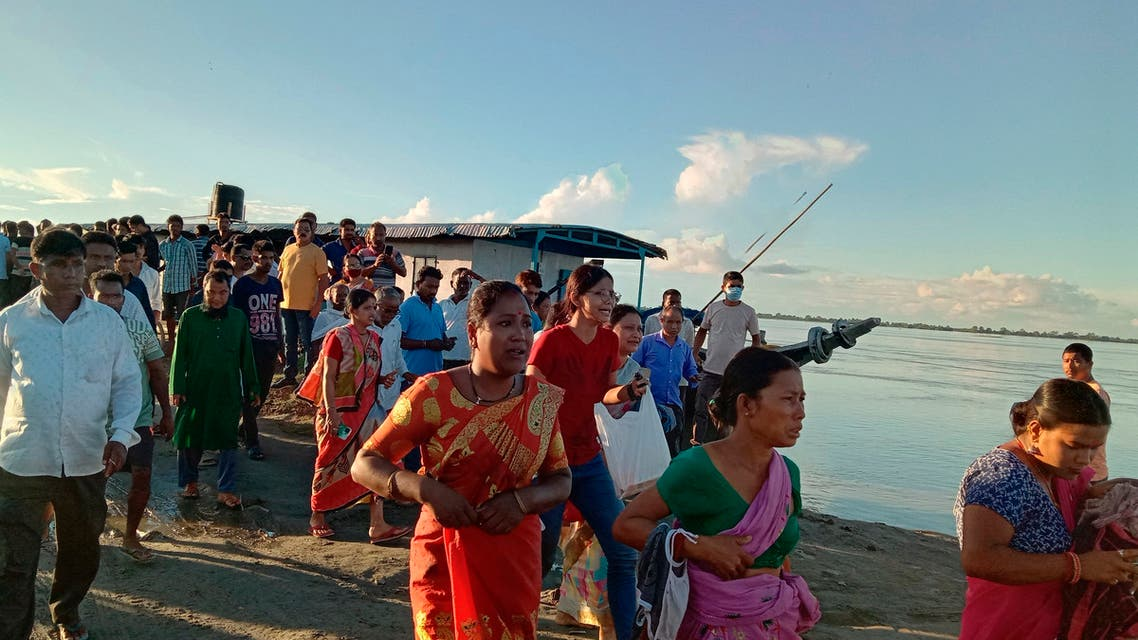 People gather at the site of a ferry capsize in the Brahmaputra river, near Nimati Ghat, in Jorhat, about 350 kilometers (220 miles) from Gauhati, the capital of the northeastern Indian state of Assam, Wednesday, Sept. 8, 2021. One person died and several are feared missing after two passenger ferries collided, an official said. The head-on collision caused one of the boats to sink, said Ashok Barman, deputy commissioner of Jorhat city. (File photo: AP)