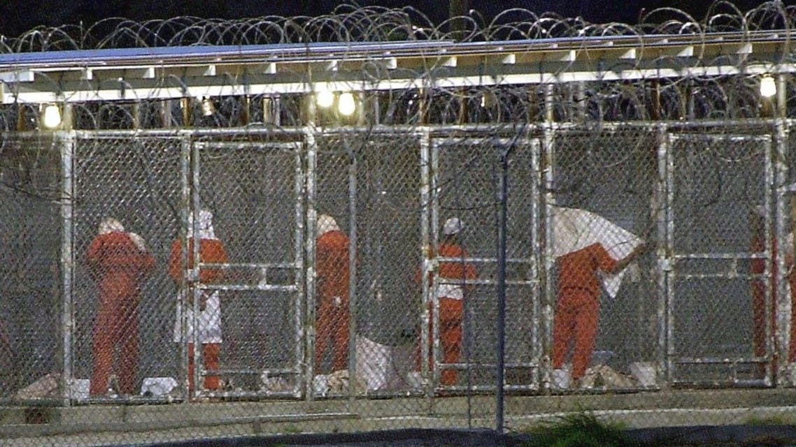 In this file photo taken on March 4, 2002, detainees at Camp X-Ray in Guantanamo Bay, Cuba. (AFP)
