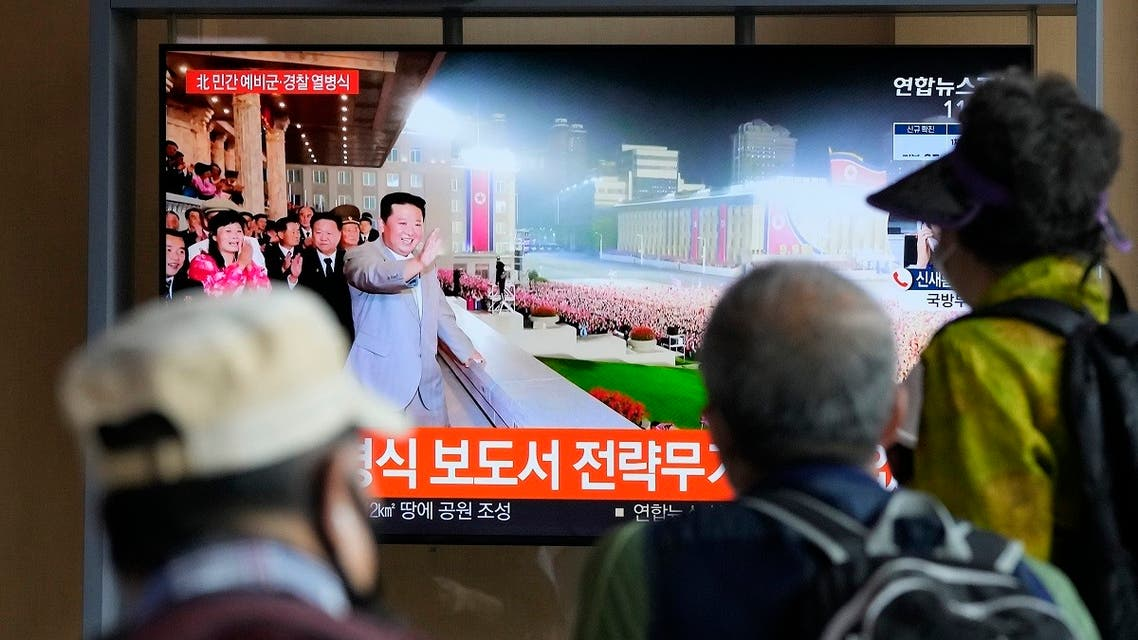 People watch a TV showing North Korean leader Kim Jong Un during a military parade held in Pyongyang, North Korea, at Seoul Railway Station in Seoul, South Korea, on Sept. 9, 2021. (AP)