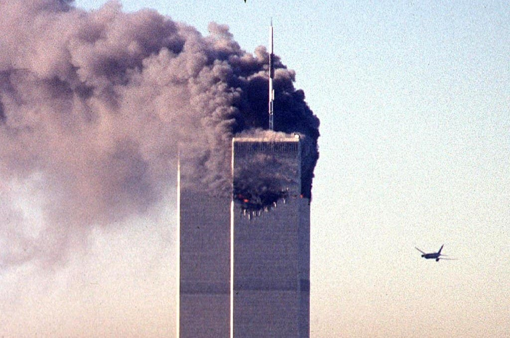 In this photo taken on September 11, 2001, a hijacked commercial aircraft approaches the twin towers of the World Trade Center shortly before crashing into the landmark skyscraper in New York. (Image: AFP)