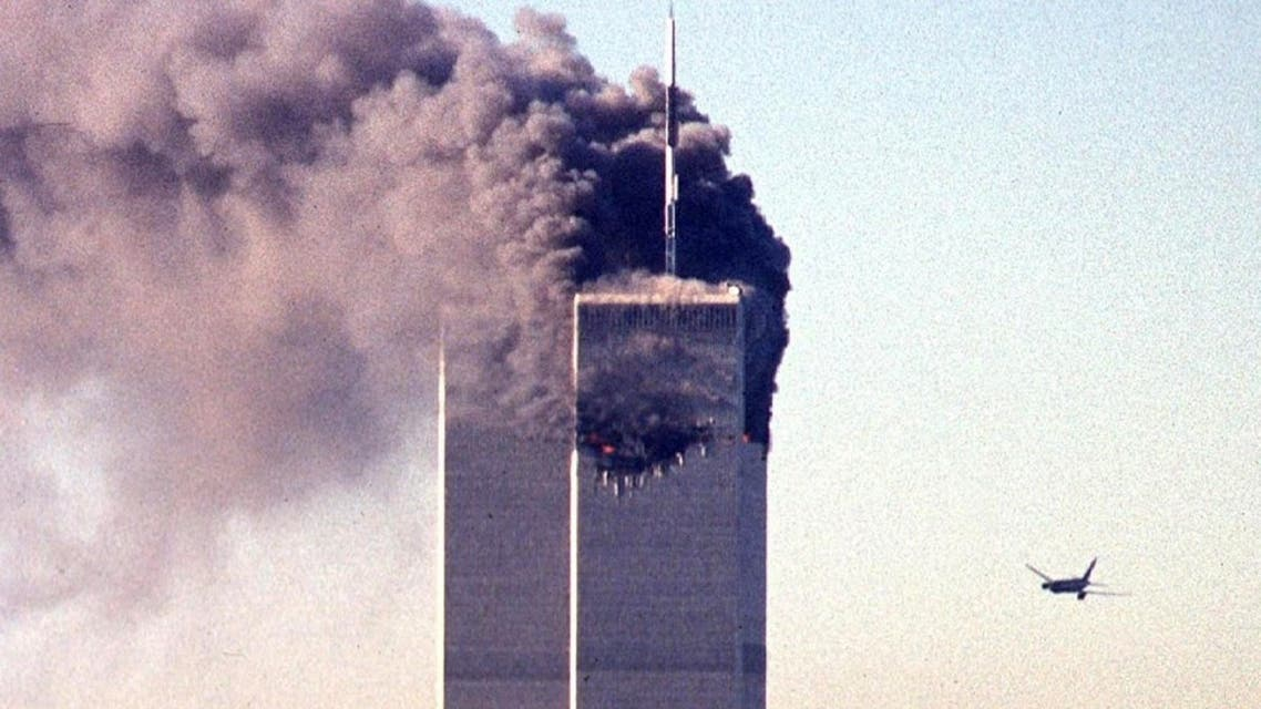 In this file photo taken on September 11, 2001, a hijacked commercial aircraft approaches the twin towers of the World Trade Center shortly before crashing into the landmark skyscraper in New York. (AFP)