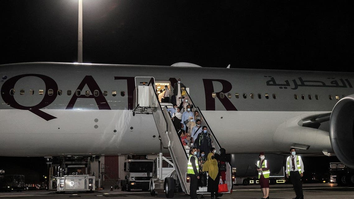 Evacuees from Afghanistan, including US citizens, arrive in Qatar's capital Doha. Sept. 9, 2021. (AFP)