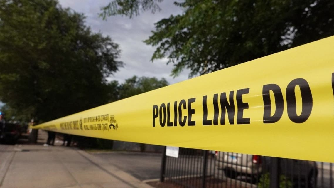 Police tape surrounds a crime scene where three people were shot at the Wentworth Gardens housing complex in the Bridgeport neighborhood on June 23, 2021 in Chicago. (AFP)