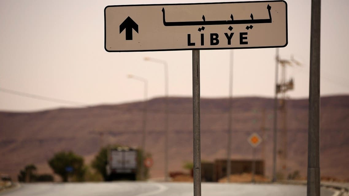 A road sign shows the direction of Libya near the border crossing at Dhiba, Tunisia. (File Photo: Reuters)