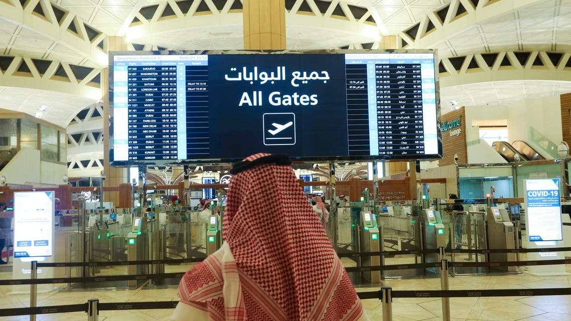 A Saudi man checks the flight timings at the King Khalid International Airport, after Saudi authorities lifted the travel ban on its citizens after fourteen months due to coronavirus disease (COVID-19) restrictions, in Riyadh, Saudi Arabia, May 16, 2021. (Reuters)