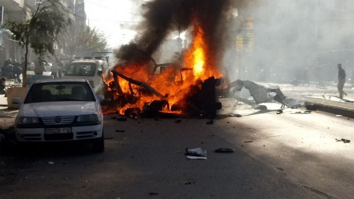 A vehicle burns at the site of a car bomb explosion in a predominantly pro-government neighbourhood of the central Syrian city of Homs on December 5, 2017. (File photo: AFP)