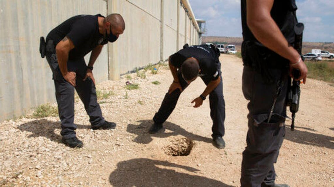 In this Monday, Sept. 6, 2021 file photo, police officers and prison guards inspect the scene of a prison escape by six Palestinian prisoners, outside the Gilboa prison in Northern Israel. (AP)