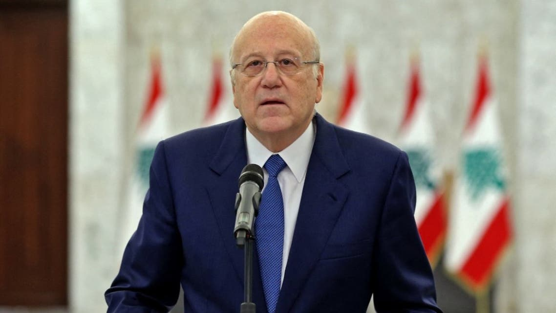 A handout picture provided by the Lebanese photo agency Dalati and Nohra on September 10, 2021 shows Prime Minister-designate Najib Mikati announcing the formation of a new Lebanese government. (AFP)