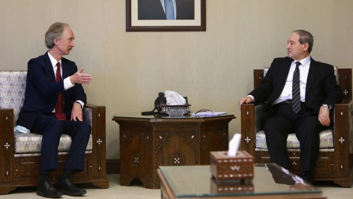 Syrian Foreign Minister Faisal Miqdad meets with United Nations Special Envoy for Syria Geir Pedersen in Damascus, on September 11, 2021. (AFP)