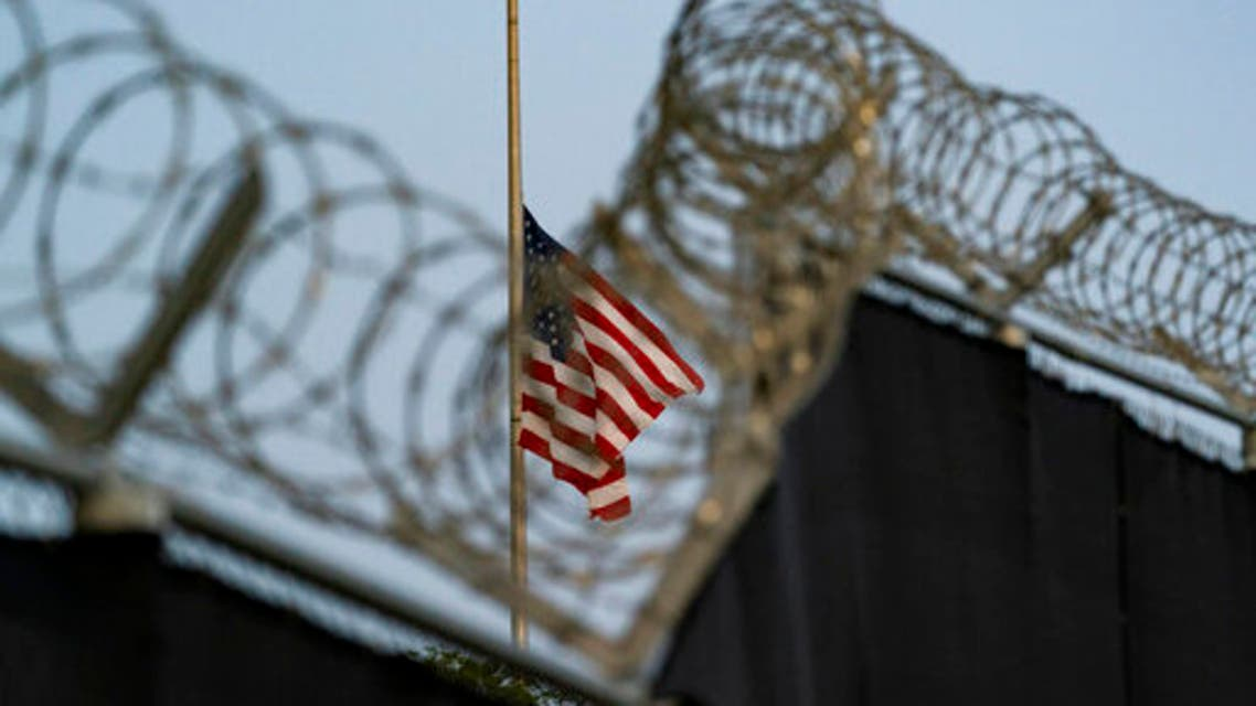 A flag flies at half-staff as seen from Camp Justice in Guantanamo Bay Naval Base, Cuba. (File photo: AP)